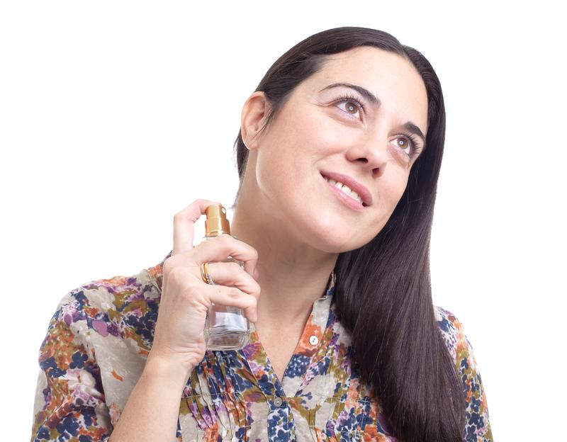 girl applying perfume