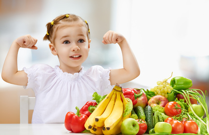 Child about to eat vegetables, and fruit