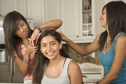 Girls taking care of their hair